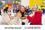 Women with pancakes during  Maslenitsa festival in Russia - stock photo