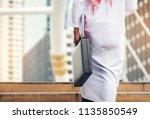 arab businessman holding a... | Shutterstock . vector #1135850549
