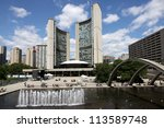 Stock photo toronto august toronto s futuristic city hall has a reflecting pond that is a popular 113589748
