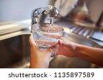 close up of children hands ... | Shutterstock . vector #1135897589