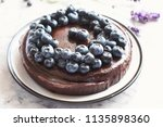 chocolate cake with blueberries.... | Shutterstock . vector #1135898360