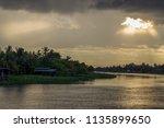 beautiful sun beams and sky... | Shutterstock . vector #1135899650
