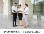 confident businesspeople... | Shutterstock . vector #1135916360