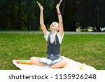 student in uniform smiles... | Shutterstock . vector #1135926248