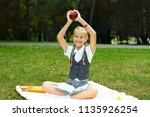 student in uniform is smiling... | Shutterstock . vector #1135926254