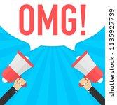 male hand holding megaphone...   Shutterstock .eps vector #1135927739