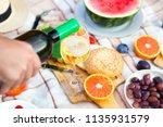 summer picnic basket on the...   Shutterstock . vector #1135931579