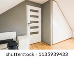 white cabinet between white... | Shutterstock . vector #1135939433