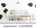 wooden bench in front of sofa... | Shutterstock . vector #1135940996