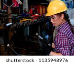 young asian engineer woman ... | Shutterstock . vector #1135948976