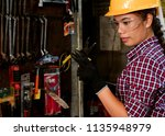 young asian engineer woman ... | Shutterstock . vector #1135948979