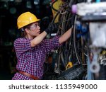 young asian engineer woman ... | Shutterstock . vector #1135949000