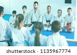 positive kids sparring in pairs ... | Shutterstock . vector #1135967774