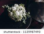 on black table lies a wedding... | Shutterstock . vector #1135987493