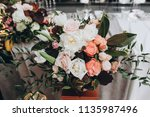 banquet table is decorated with ... | Shutterstock . vector #1135987496