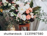 in banquet hall next to table... | Shutterstock . vector #1135987580