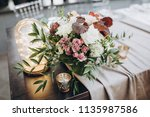 banquet table is decorated with ... | Shutterstock . vector #1135987586