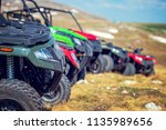 parked in a row several atv... | Shutterstock . vector #1135989656