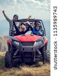 friends driving off road with... | Shutterstock . vector #1135989743