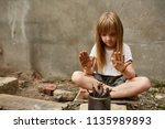 neglected lonely child warming... | Shutterstock . vector #1135989893