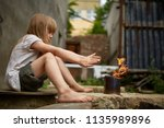 neglected lonely child warming... | Shutterstock . vector #1135989896
