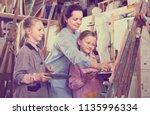 smiling woman teacher giving... | Shutterstock . vector #1135996334