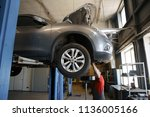 car mechanic fixing tie rod and ... | Shutterstock . vector #1136005166