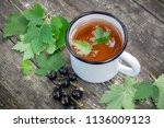 enameled cup of fruit tea with...   Shutterstock . vector #1136009123