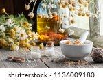 mortar of dried healing herbs ...   Shutterstock . vector #1136009180