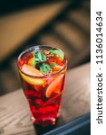 strawberry mojito cocktail with ... | Shutterstock . vector #1136014634