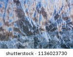 water flowing on the wall ... | Shutterstock . vector #1136023730