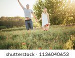 happy couple in love. man and a ... | Shutterstock . vector #1136040653