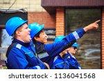 group of  builders in hardhats. ... | Shutterstock . vector #1136041568