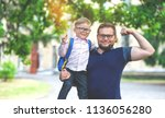 back to school. happy father... | Shutterstock . vector #1136056280
