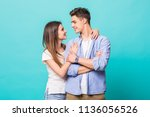 portrait of a young couple hug... | Shutterstock . vector #1136056526