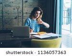 young shocked female programmer ...   Shutterstock . vector #1136057363