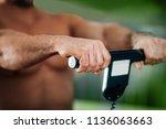 male athlete  measuring  body... | Shutterstock . vector #1136063663
