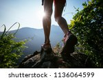 successful hiker hiking on... | Shutterstock . vector #1136064599