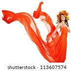 Girl with wreath of autumn leaves and orange dress. Art photo. - stock photo