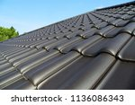 new tiled roof | Shutterstock . vector #1136086343