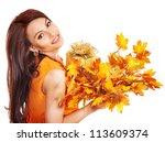 Woman holding gift box . Autumn season. - stock photo