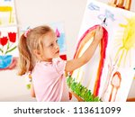 child painting at easel in... | Shutterstock . vector #113611099