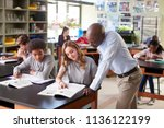 male high school tutor teaching ... | Shutterstock . vector #1136122199