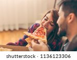 couple in love eating pizza for ... | Shutterstock . vector #1136123306
