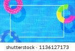 swim rings on swimming pool... | Shutterstock .eps vector #1136127173