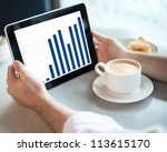 man holding tablet computer... | Shutterstock . vector #113615170