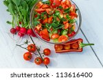 Fresh vegetables in sunny garden on old plank - stock photo