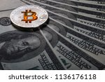 coins of bitcoin on the... | Shutterstock . vector #1136176118