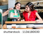 cheerful woman happy to eat... | Shutterstock . vector #1136180030