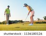 full length of a woman... | Shutterstock . vector #1136180126